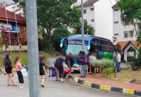 The suspects being brought to Bentong police station.
