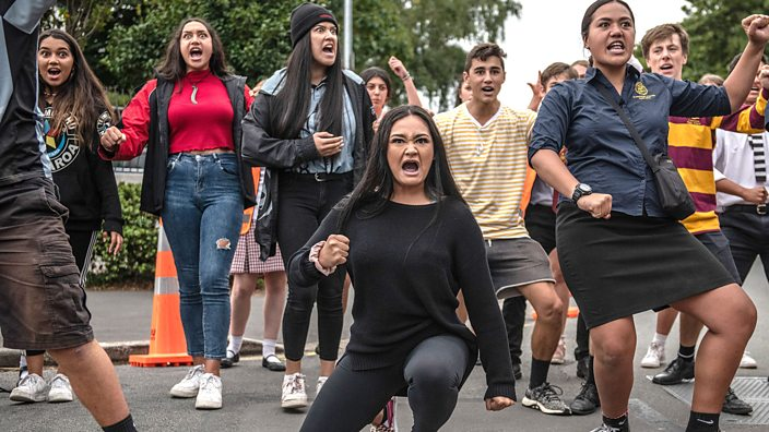 Students perform the haka as they gather in a vigil to commemorate victims of Friday's shooting.
