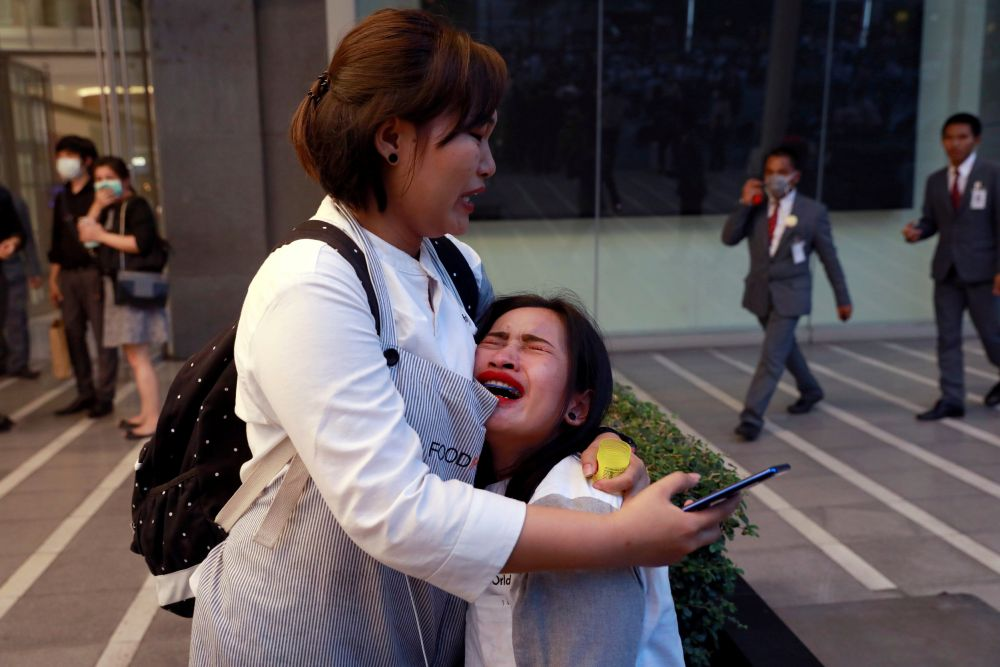 A woman breaks down outside CentralWorld.