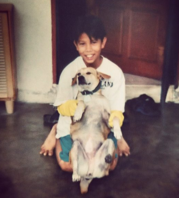 Young Jared with his late pet dog, Passion.