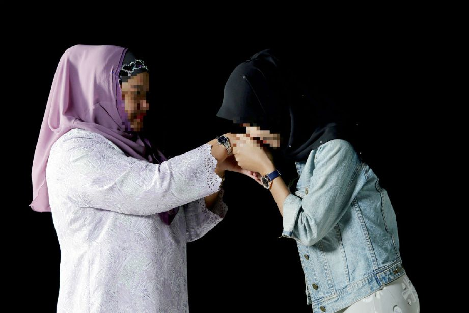 The victim (right) greeting the man's 38-year-old wife earlier today, 22 April.