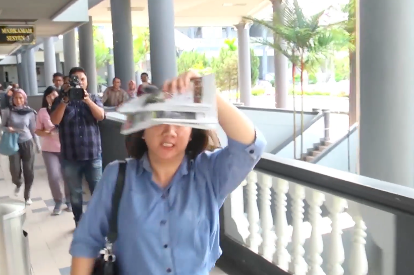 Screenshot from the video showing the woman charging at the man.