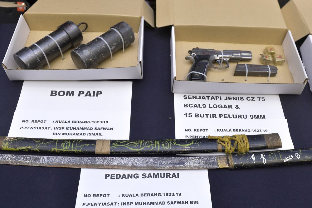 Weapons and explosives seized during the raids.
