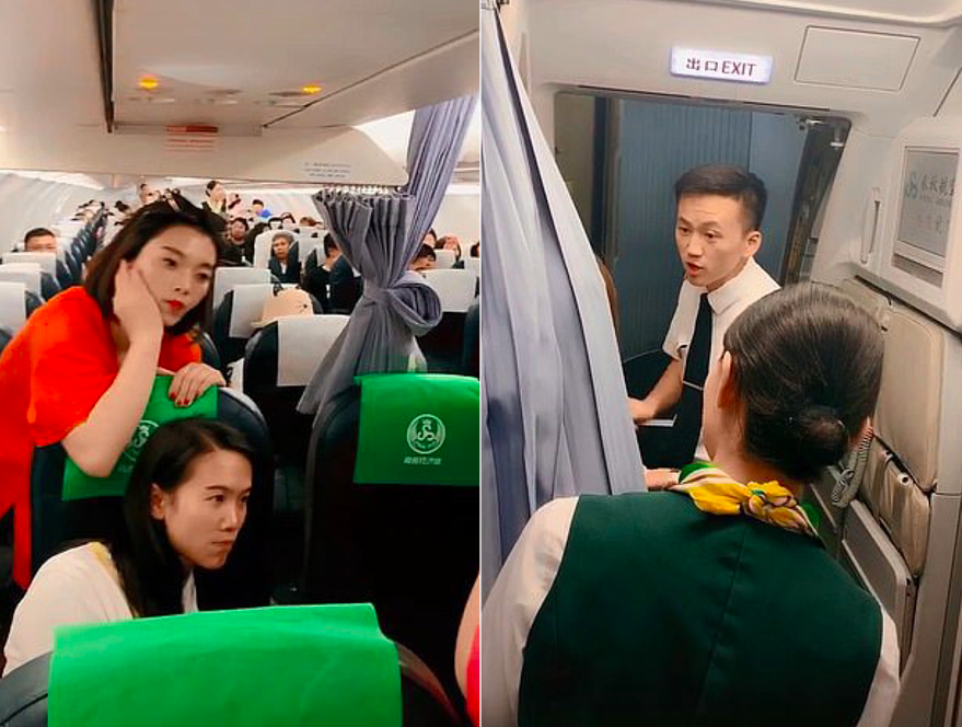 Cabin crew trying to calm down travellers stranded on the plane.