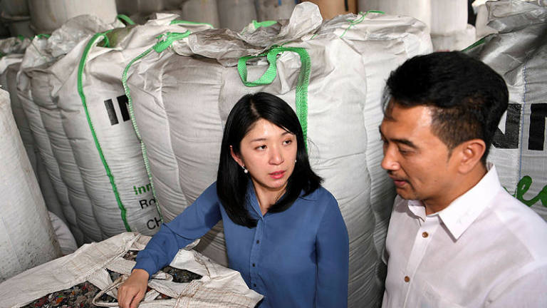 Yeo Bee Yin and Port Klang assemblyman Azmizam Zaman Huri at the illegal plastic waste recycling factory in Telok Gong on Jan 17, 2019.