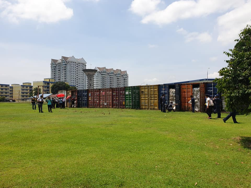 An overview photo of 11 containers at the Customs Detention Depot.