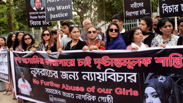 Bangladeshi women hold banners of Nusrat Jahan Rafi and the headmaster at a protest in Dhaka in April following her murder.