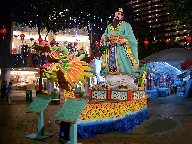 Statue of Qu Yuan on a dragon boat, on display for the Dragon Boat Festival, in one of Singapore's central streets.