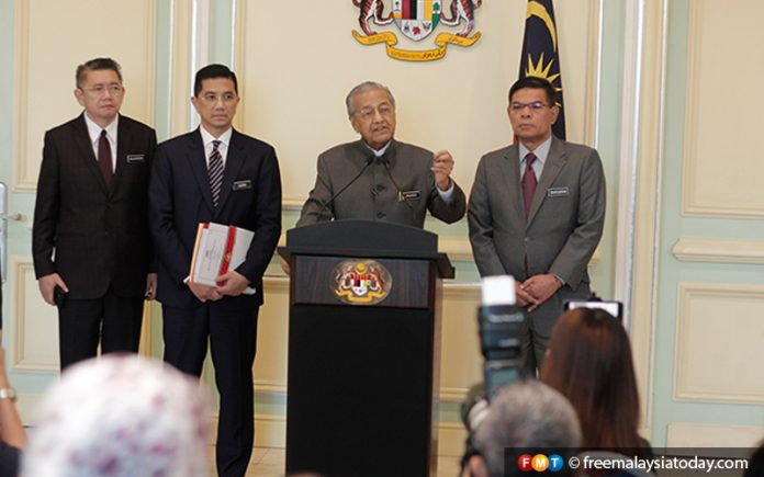 Mahathir speaking during a press conference in Putrajaya today.