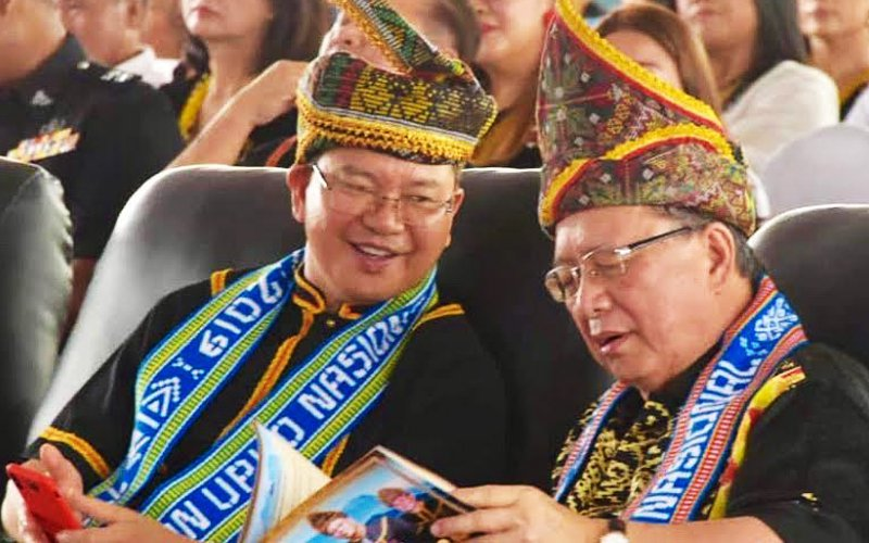 Sabah Deputy Chief Minister Wilfred Madius Tangau (left) and Upko honorary president Bernard Dompok in traditional costumes at the 2019 Upko Kaamatan celebrations at Telupid over the weekend.