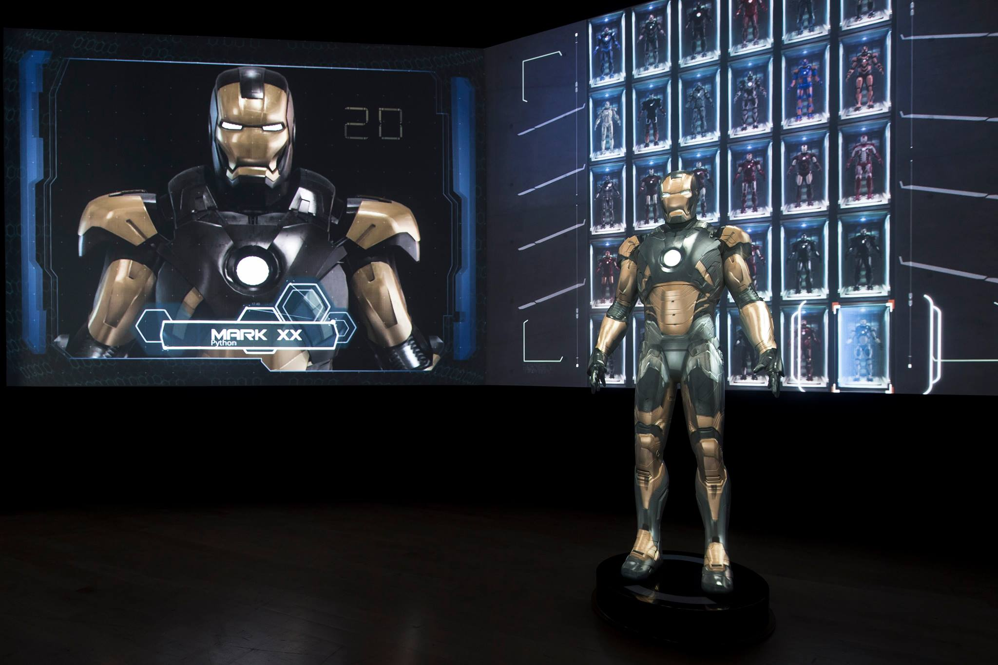 42 Iron Man suits projected in 3D.