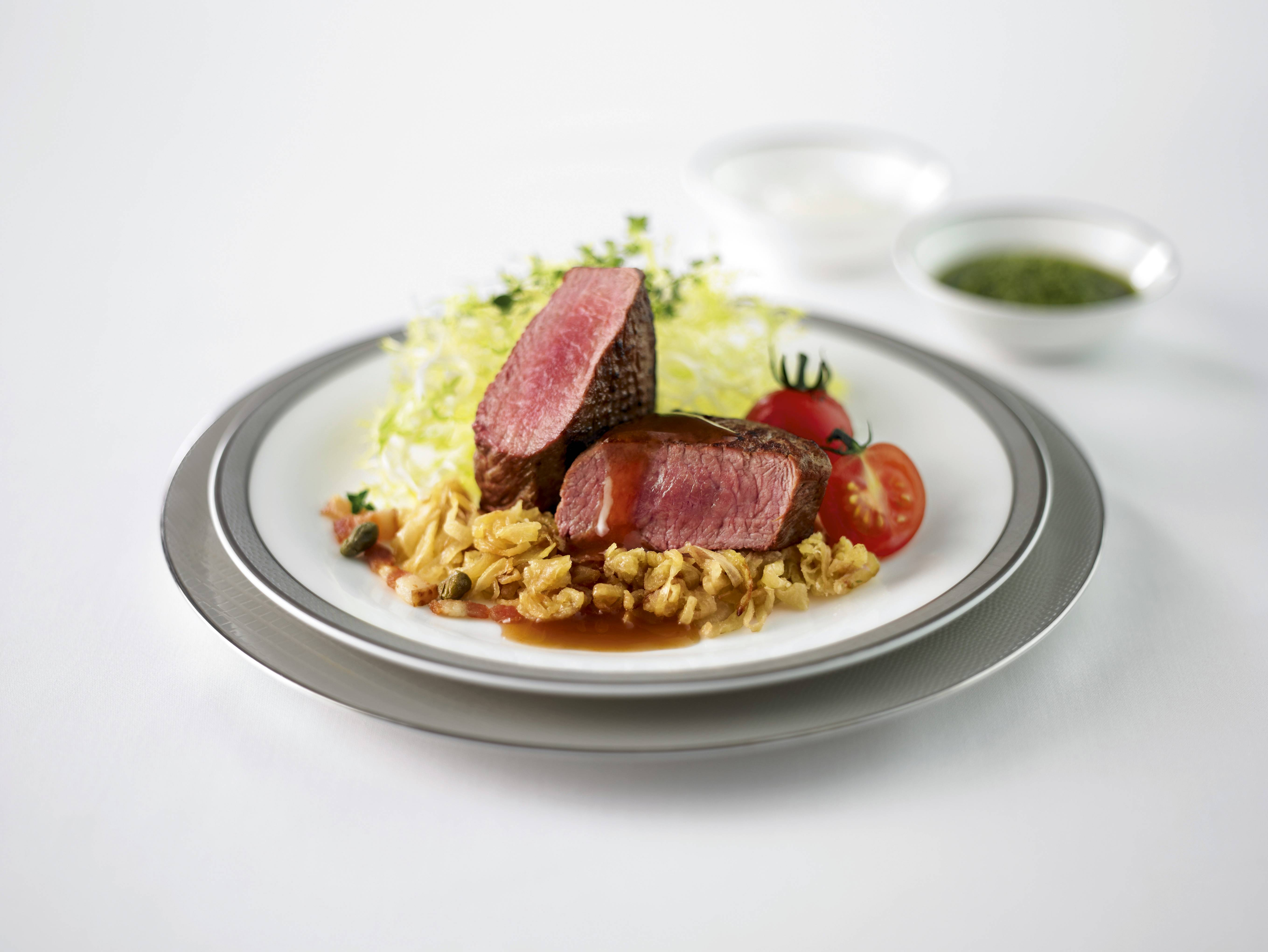 Seared Lamb Loin is available in the 'Book the Cook' menu for Business Class from Singapore.