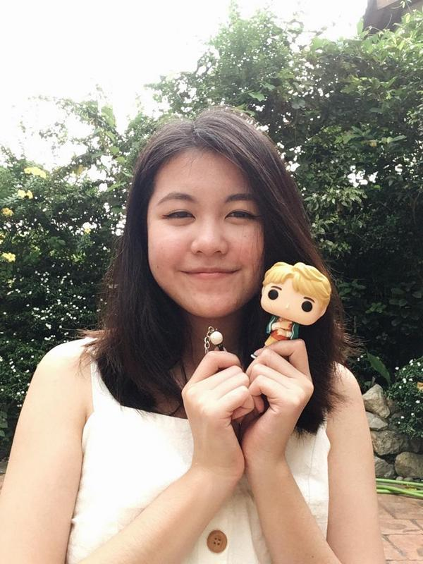 Natasha showing off her BTS - RM Pop! Vinyl Figure and mini ARMY BOMB.