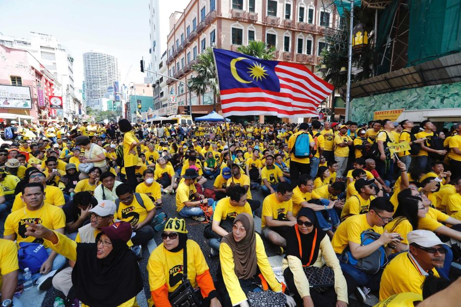 File photo of anti-government protesters occupying a street during a rally in KL.