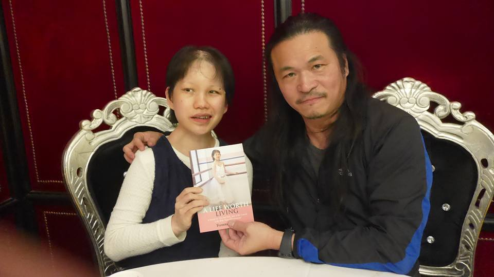 Foong (left) with her book 'A Life Worth Living'.