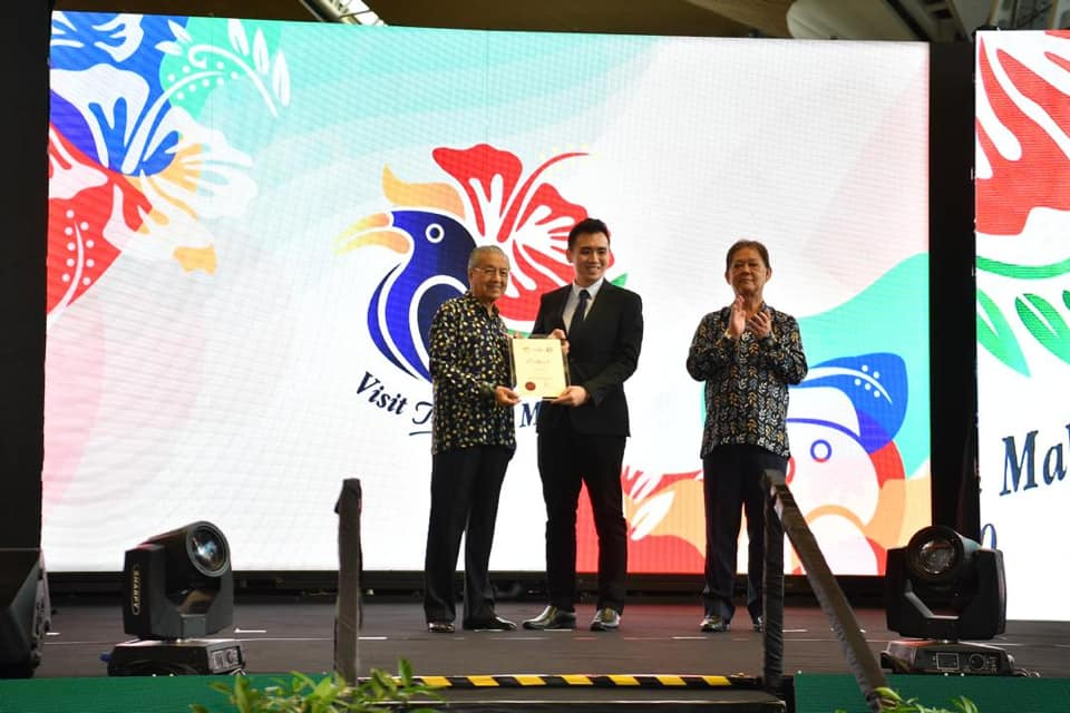 Graphic designer and winner of the logo contest, Alfred Phua Hong Fook.