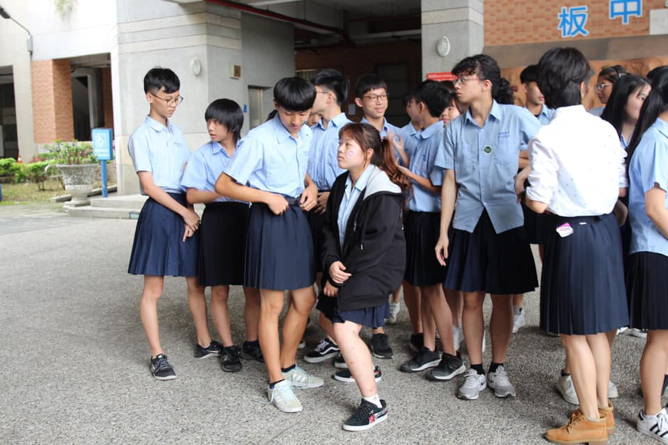 Male students at Banqiao Senior High School are seen wearing skirts along with their female counterparts during a week-long campaign to dismantle gender stereotypes in May this year.
