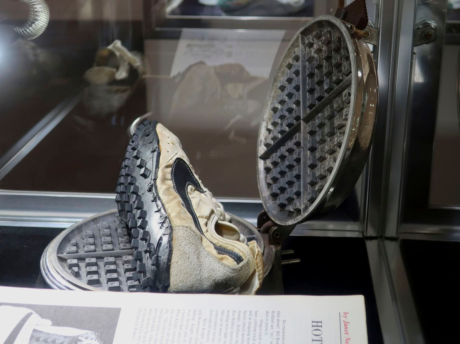 The shoe, created during Nike's infancy, is one of only a handful given away for the 1972 Olympic Trials, seen sitting inside a waffle iron here during the Sotheby's auction on Tuesday.