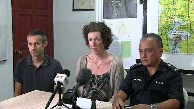 Meabh Quoirin (middle) and her husband Sebastien Quoirin (left) at a press conference.
