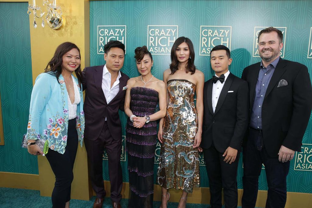Adele Lim, with director Jon M. Chu, Michelle Yeoh, Gemma Chan, Ronny Chieng and co-writer Peter Chiarelli at the premiere of Crazy Rich Asians.