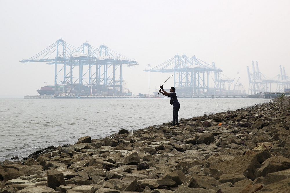 A man is seen fishing on a hazy day in Northport Klang on 9 September.
