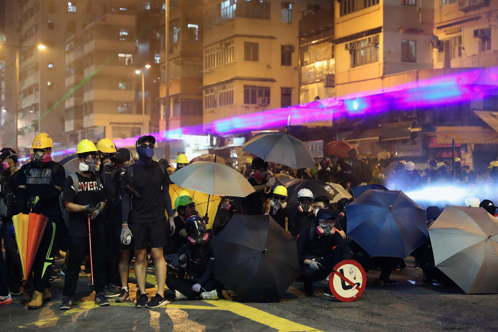 People of Hong Kong defied the official protest ban to turn up for demonstrations across the city.