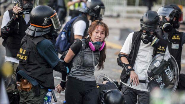 Police detain demonstrators in Hong Kong's Sha Tin district.