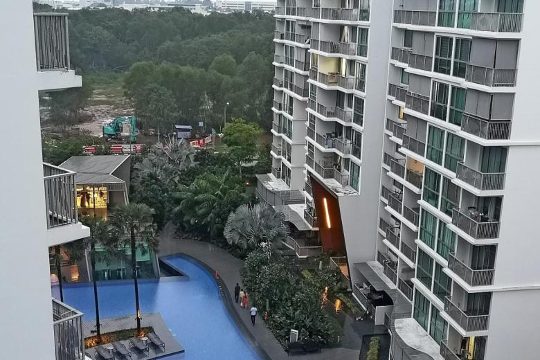 The walkway the TV landed on leads to the condominium's swimming pool and fitness facilities.