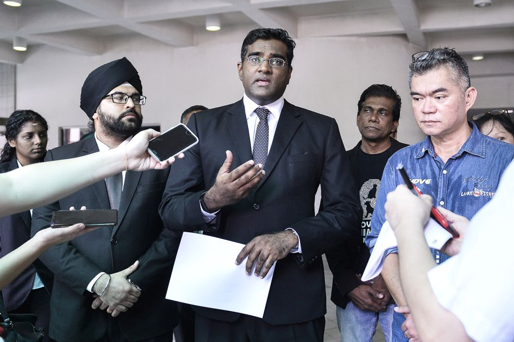 From left to right: lawyer Sachpreetraj Singh Sohanpal, lawyer Rajesh Nagarajan, and Koh Tat Meng.