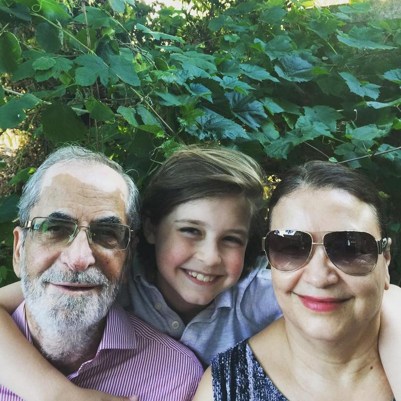 Laurent and his grandparents.