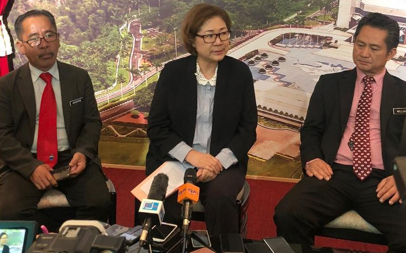 Christina Liew (centre) and Sabah Wildlife Department director Augustine Tuuga (left) speaking to media in Kota Kinabalu yesterday.
