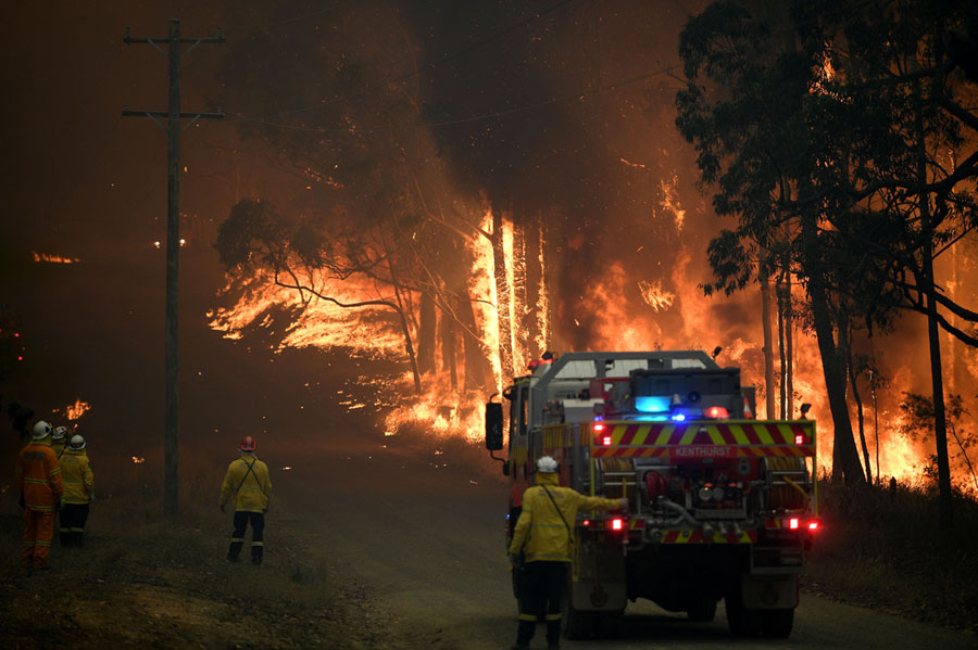 New South Wales Rural Fire Service fights a fire as it burns close to a property northwest of Sydney on 19 November.