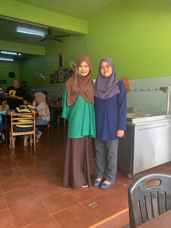 (Left to right) Nasi Beriani Haji Tamby Padang restaurant owner Amelia Tamby Hussin with one of her customers.