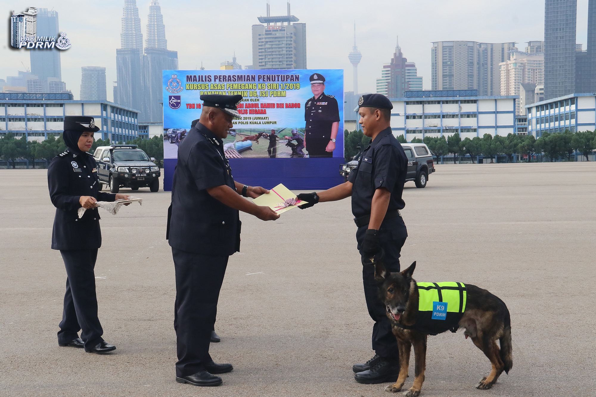 Urby and his handler being honoured during the closing event of a K-9 unit handler course at the Police Training Centre on Friday.