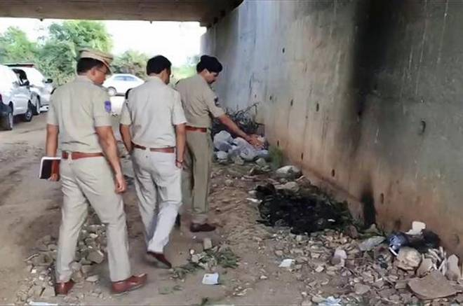 Police officers inspecting the site where they found the body the victim on the outskirts of Hyderabad.