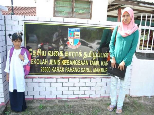 Husna with her mother, Nurul Fadznie Ashikin, at SJKT Karak for Orientation Day last Saturday, 28 December.
