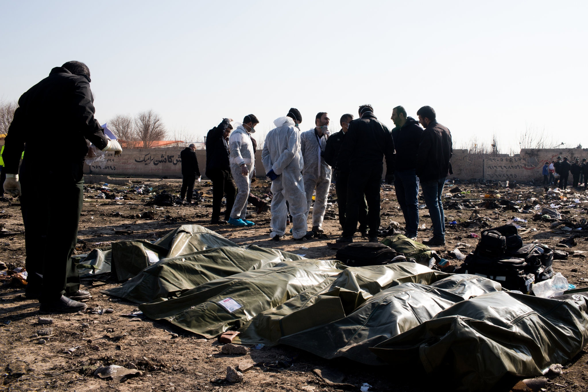 Collecting bodies from the downed plane on Wednesday in Tehran.