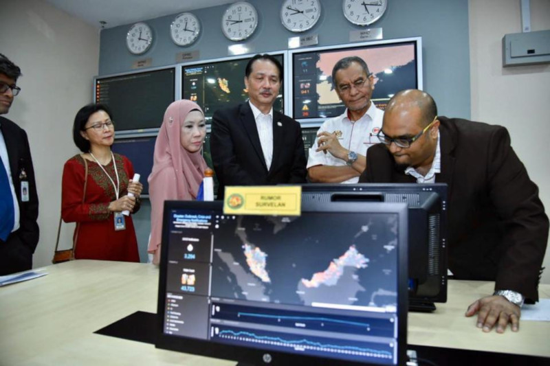 Health Minister Dzulkefly Ahmad and Health director-general Dr Noor Hisham Abdullah monitoring the spread of the virus in Malaysia at the National Crisis Preparedness and Response Centre in Putrajaya 25 January.