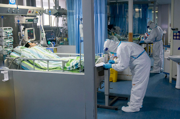 A medical worker attends to a patient in the intensive care unit at Zhongnan Hospital of Wuhan University in Wuhan.