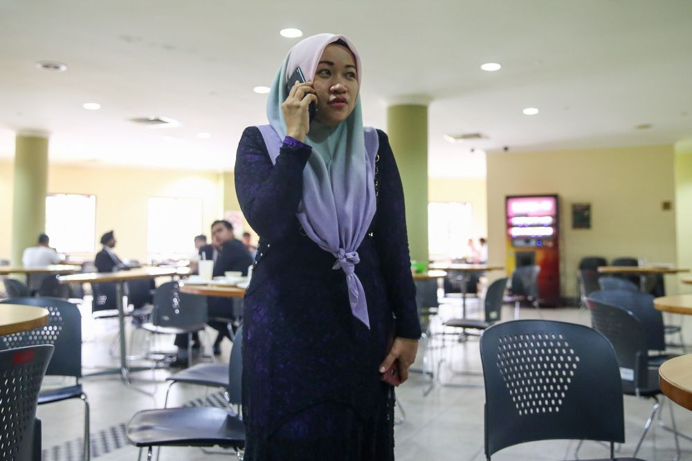 The journalist pictured at the Kuala Lumpur High Court.
