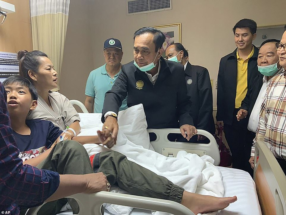 Thailand's Prime Minister Prayuth Chan-ocha visits a hospital to see victims of the mass shooting in Nakhon Ratchasima.