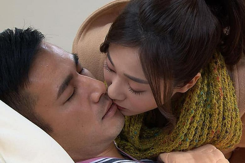 Actress Mia Chiu and actor Jun Fu in a scene in Taiwanese TV serial 'Golden City.'