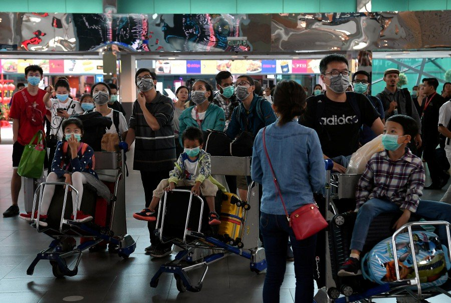 Image of tourists wearing facemask at KLIA used for illustration purposes only.