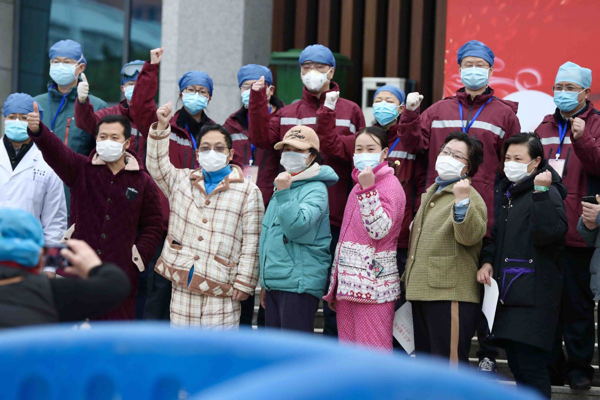 Discharged patients show their confidence outside a makeshift hospital in Hubei province on 11 February.