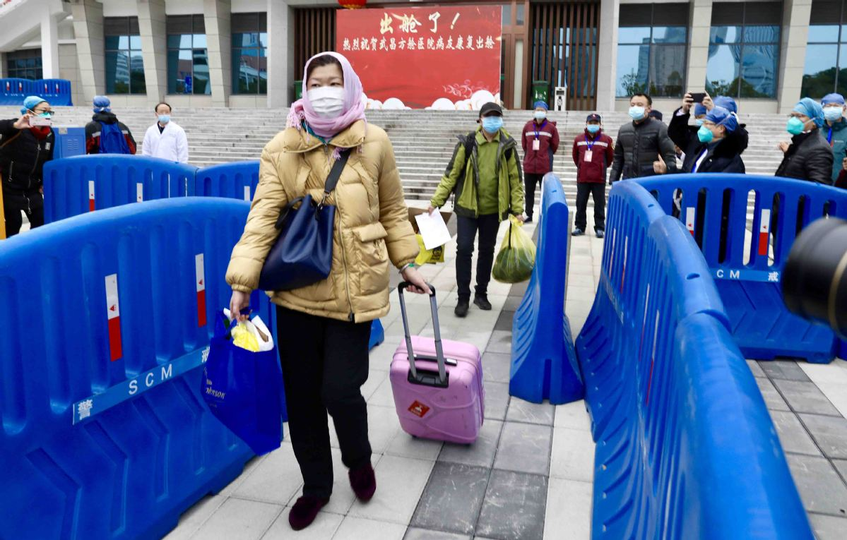 A discharged patient walking out of a hospital in Hubei province on 11 February.