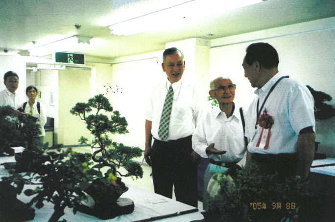 Watanabe (centre) showing his bonsai trees off at Joetsu City Senior Exhibition in 2005.