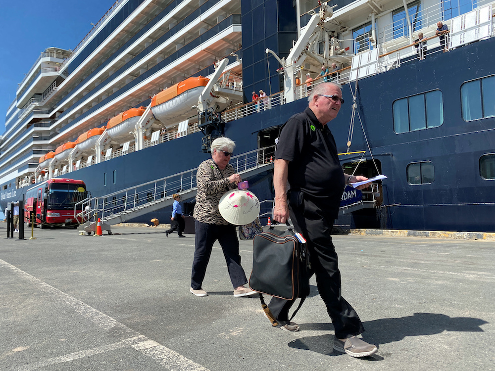 Passengers leaving the cruise ship docked in Cambodia.