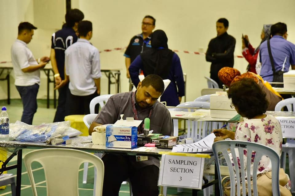 Passengers undergoing health screening at the Air Disaster Unit (ADU) in KLIA when they arrived safely back on Wednesday, 26 February.