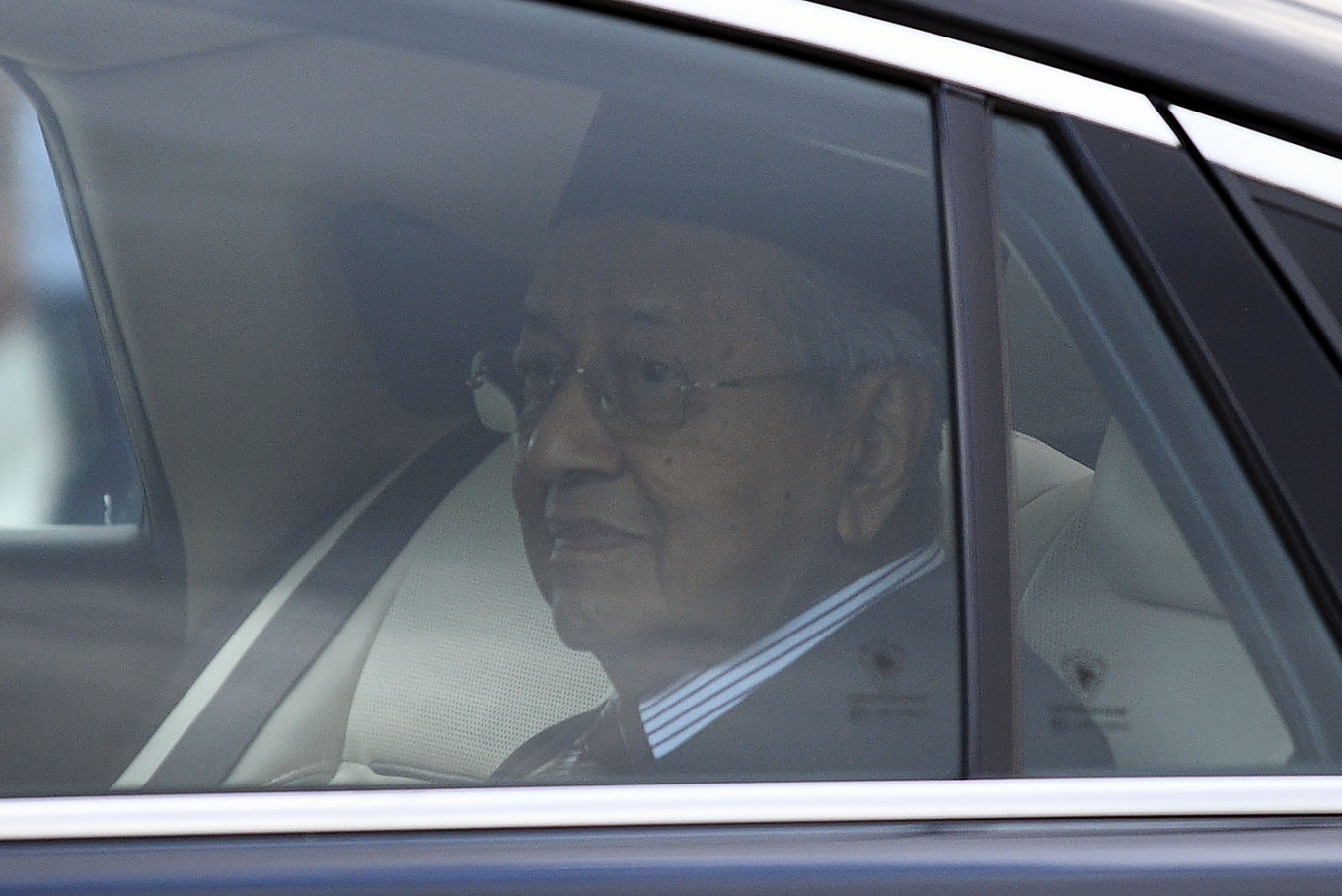 Dr Mahathir looks on as he leaves the Palace on 24 February.