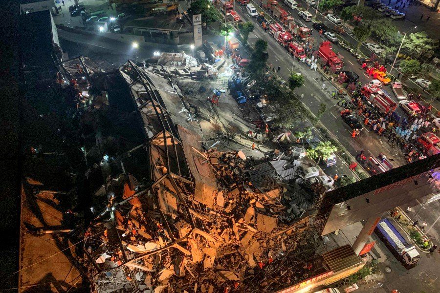 Rescuers search for survivors in the rubble of the collapsed hotel.